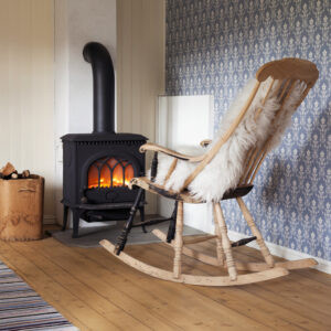 rocking chair by a freestanding fireplace